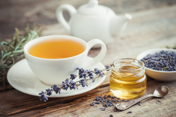 Healthy tea cup, honey, dry lavender flowers and teapot